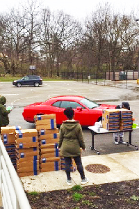 Cars_Lining_Up_To_Pick_Up_Meals_for_their_families.jpg