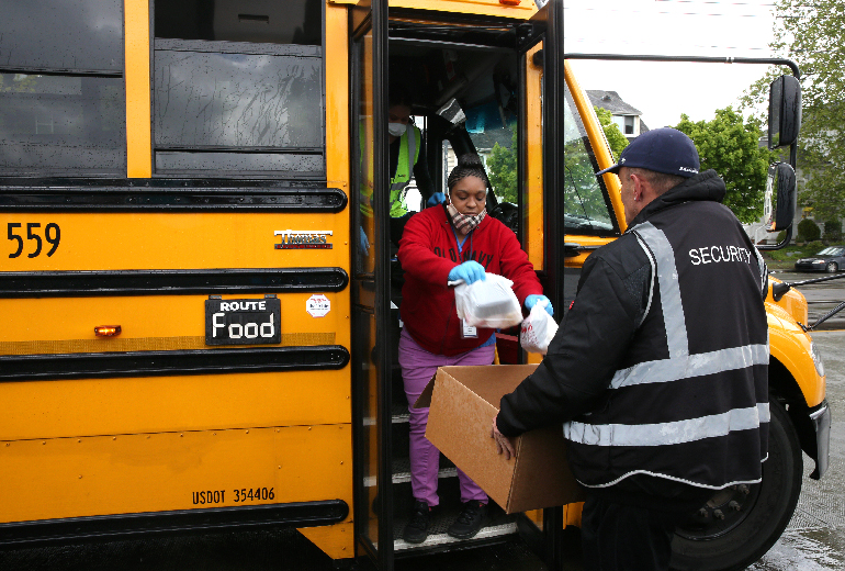 packaged meal distribution migrated from school sites to bus stops.jpg