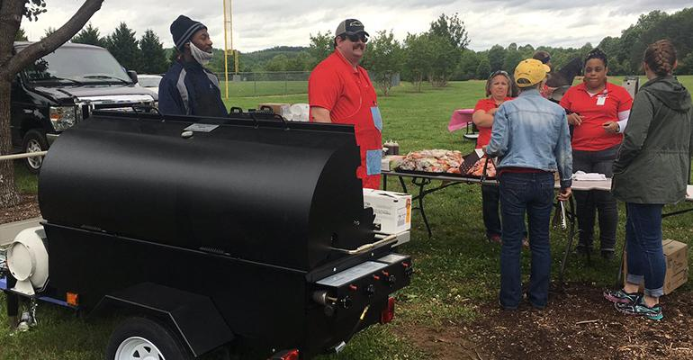 The kick-off event of Henry County Schools' new grill cookout program drew more than a hundred children and close to 30 adults on a cool, cloudy day.