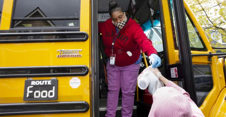 School-Bus-Delivers-Lunches-To-Kids-During-Coronavirus-Shutdownjpg.jpg