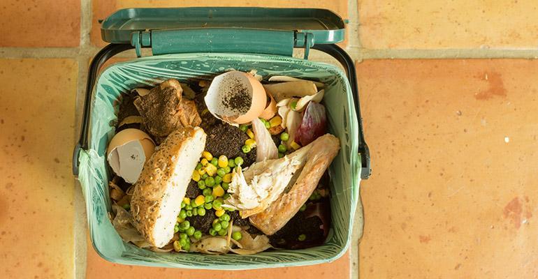 Wasteful food in trashcan - Thinkstock Photos