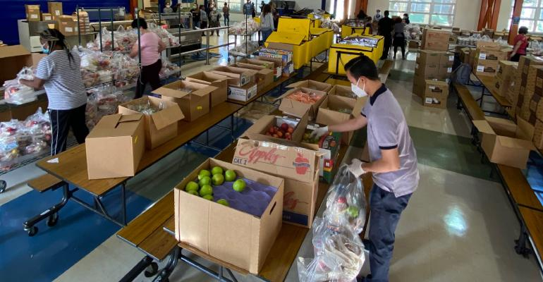 foodserivice-staff-pack-bags-for-distribution.jpg