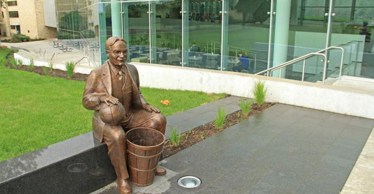 A statue of basketball inventor james Naismith with his famous peach basket sits outside KU39s DeBruce Center