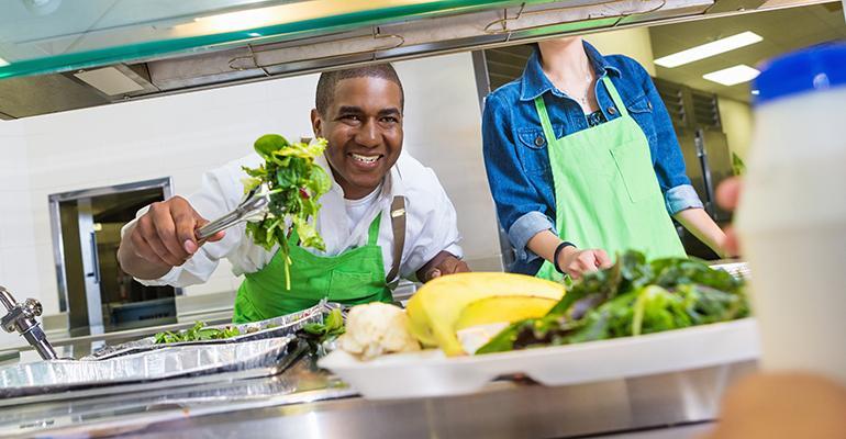 school-caafeteria-worker-serving-lunch.jpg