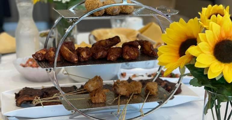 table_w_flowers_Peace_Village_Tapas_Dinner.jpg