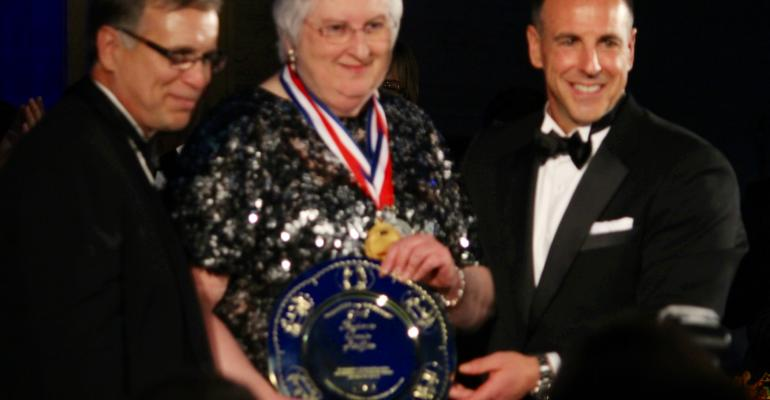 IFMA PresidentCEO Larry Oberkfell l and Chairman Mark Bendix present the Gold Plate Award to Kansas State Universitys Mary Molt at the Gala Gold  Silver Plate Awards Banquet on May 7th