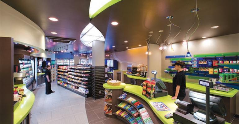 GO WITH THE FLOW Created in a former FedexKinkos location at the schools University Center Munchy Mart features colorchanging lighting and a flowing floor layout in a long narrow space