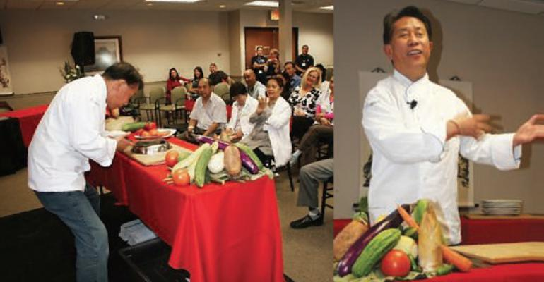 Yan demonstrates some of the dishes preparations to hospital staff