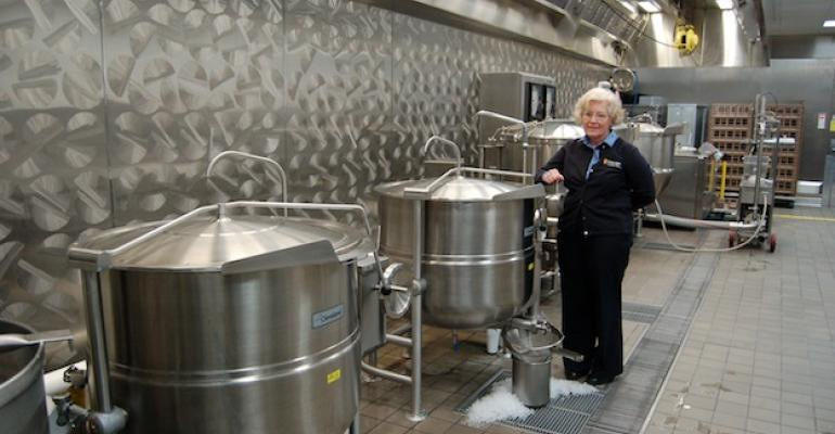 Gordon Dining  Event Center Unit Manager Barbara Phelan with some of the 80 and 100gallon kettles in the centers huge central production facility which supplies product across the campus