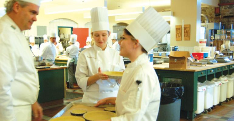 While making tarts students check each step of the process with their instructor who takes time to go over the details After a long morning of class the finished tarts will become dessert for the big lunch where students reconvene