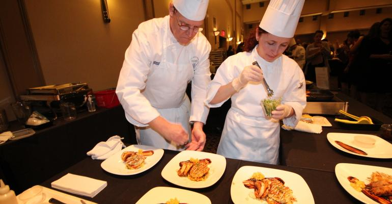 HEALTHY COMPETITION Executive Chef Jim Roth CEC and Lead Retail Cook Yanka Manikatova of Elmhurst Memorial Healthcare in Illinois get ready to let the judges taste their entry Potato Pearls Goat Cheese Mashed Potato Cake which featured New Orleansstyle BBQ shrimp and maque choux All entries were under 700 calories and met other nutrition requirements