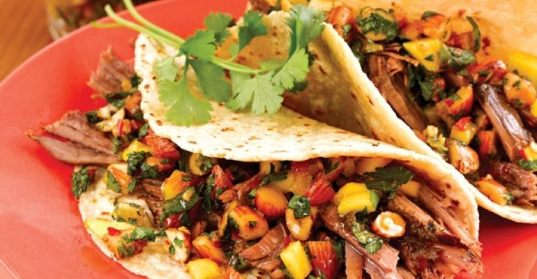 Mexican snacks sold in roadside stands are sometimes called antojitos or little cravings Try small tacos like these Beef Barbacoa beauties with Almond Mojo