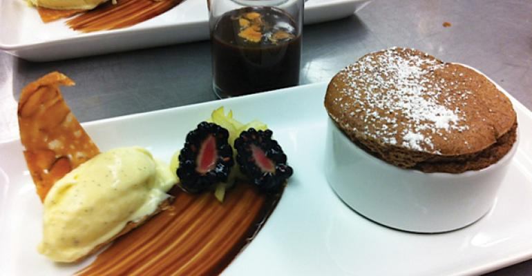 At UC San Diego Senior Executive Chef Vaughn Vargus CEC CCA spikes a chocolate souffle with a kick of heat mesquite powder Served with  vanilla bean ice cream almond tuile blackberries and chocolate brittle ganache the souffle was recently awarded a gold medal at an ACF competition