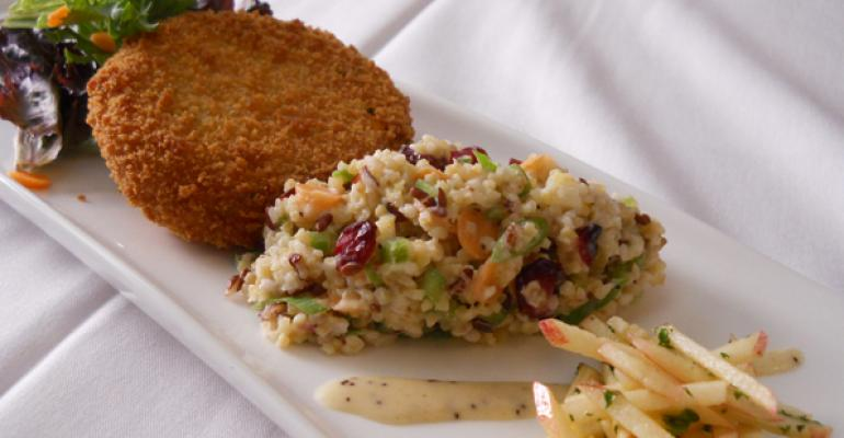 Autumn Grain and Apple Salad middle next to Sweet Potato and Corn Fritter left and apple slaw part of Metz Culinary Managements new whole grains initiative which features a dozen new whole grain menu items See the recipe for the grain salad at the bottom of this article