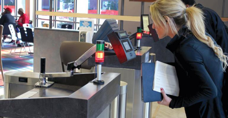 A Georgia Southern student checks into a dining hall using eye scan validation
