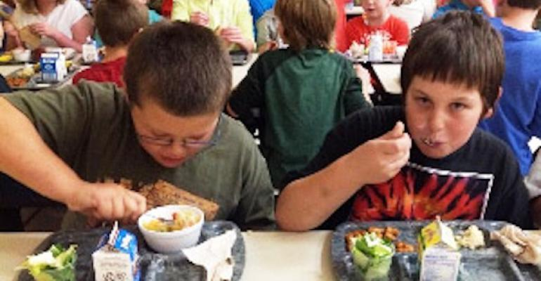 Students enjoy the Mexican Rice Bowl developed by Kay Briles head cook for Greenfield Elementary School in Baldwin WI that won the Grand Prize in the Rice Bowl category in USA Rice39s 2013 Healthy Brown Rice on the Menu Contest for K12 schools