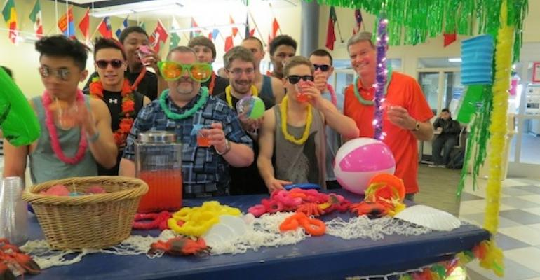 Bob Meyer Sodexo General Manager at Northampton Community College c with large glasses joins students and school president Dr Mark Erickson far r to celebrate a spring break on campus after the school had to cancel the actual spring break due to too many snow days