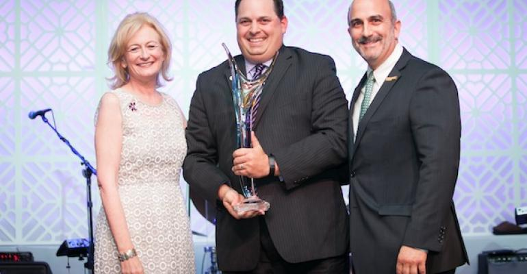 NRA PresidentCEO Dawn Sweeney and Convention Chair Sam Facchini of Metro Pizza flank Dan Henroid director of nutrition and foodservice for UCSF Medical Center as he accepts the 2014 Innovator of the Year Award