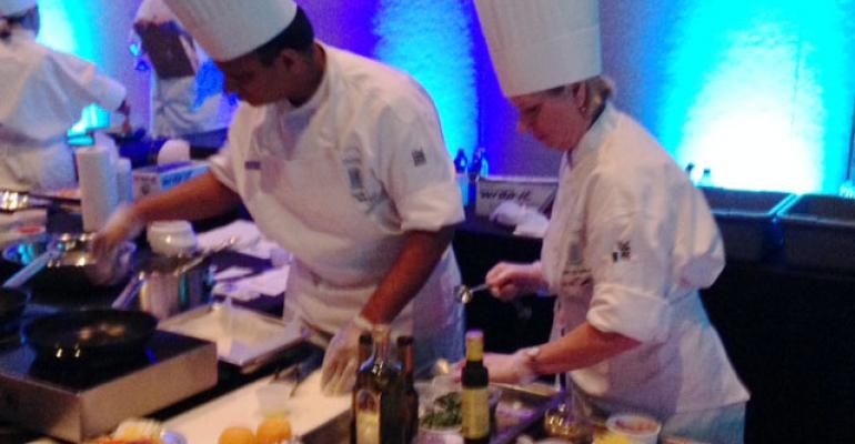Aatul Jain and Joanne McMillian of Saint Clare Health System prepare their winning dish at the 2014 AHF Culinary Competition in Orlando