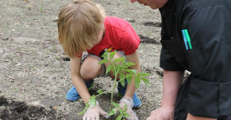 OUTDOOR CLASSROOM Gardening at Winchester Thurston School is a great way for kindergartners to learn