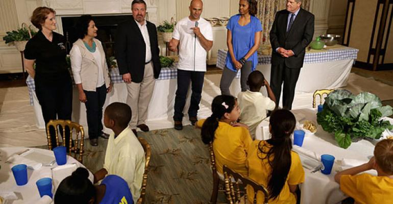 Orange County Schools Director Lora Gilbert Dallas Independent School Director Dora Rivas West Virginia Department of Education Office of Child Nutrition Director Richard Goff Director of Letrsquos Move Sam Kass Michelle Obama and Agriculture Secretary Tom Vilsack join students to make a meal using the summer crop from the White House Kitchen Garden The directors are from districts that have been successful since the new standards were put in place by the Healthy HungerFree Kids Act