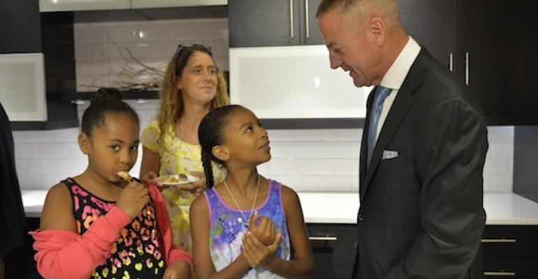 Aramark PresidentCEO Eric Foss spends time with a family at the announcement of Aramarkrsquos partnership with The Childrenrsquos Hospital of Philadelphia on Home Plate an innovative threeyear study designed to combat childhood obesity by enhancing family health and wellbeing through good nutrition