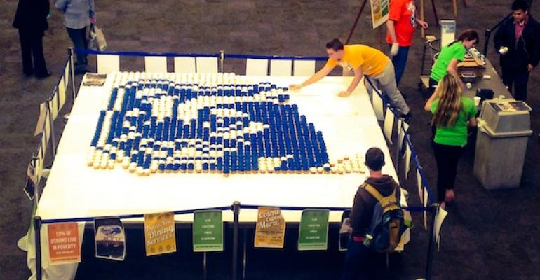BYU Students helped construct a giant mural made of 2100 blue and white cupcakes for a fundraising effort to benefit the local Provo Food Bank