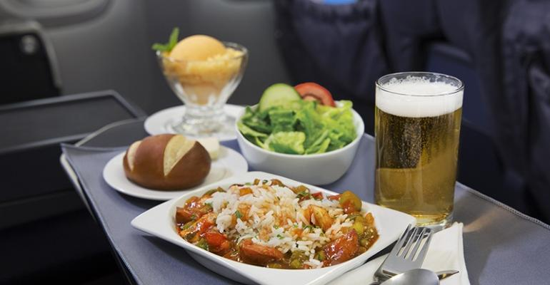 Chicken and sausage jambalaya with white rice and green unions will be one of Unitedrsquos new premiumcabin dishes for United First and United Business customers on flights within North America