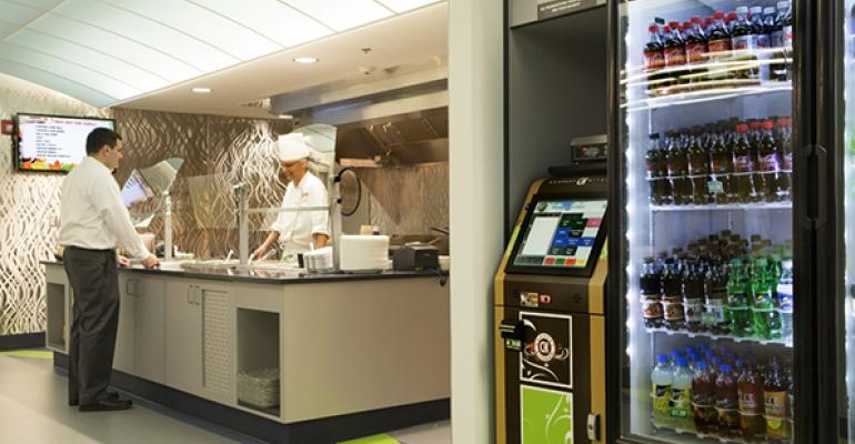 A Treat America unit with a manned chef station and attached micromarket with selfserve kiosk