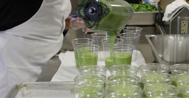 A staffer prepares quotGreen Machinequot breakfast smoothies made with mango pineapple banana spinach yogurt and milk