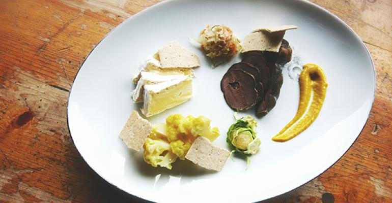 Pastrami39d Sterlingraised beef heart Sterling fermented kraut and pickled cauliflower Haribson cheese from Jasper Hill with mustard andhomegrown Brussels sprouts