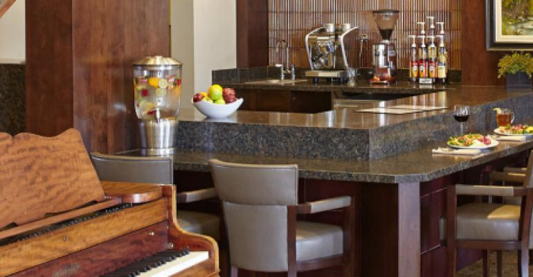 The Casey39s Village dining room with piano and agua fresca water dispenser