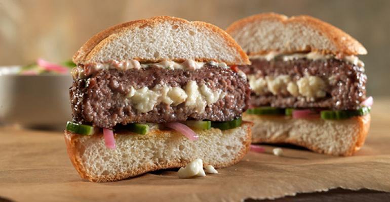 This Mediterranean Lamburger has a cheesy surprise inside The pickled onions and cucumbers add another ontrend dimension