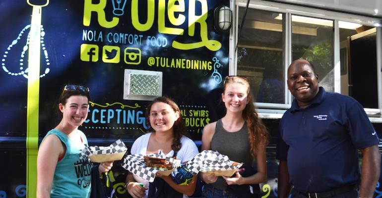 TJ Talabi director of resident dining for Sodexo at Tulane with some satisfied customers of the school39s new Rouler food truck