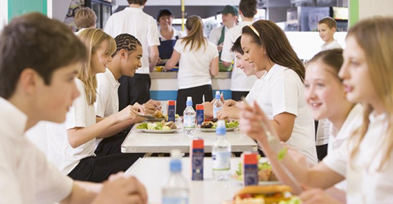 District returns high schools to federal meal program