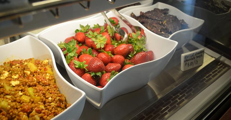 Wholegrain salad fresh strawberries and apricotcranberry chocolate bark in the cold case