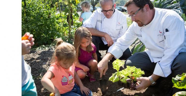 Chartwells K12 chefs Josh Perkins l and Will Ratley with some young gardeners at the Pattonville Mo Youth Garden one of the pilot programs associated with the ldquoeat learn liverdquo program