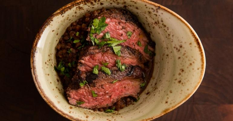 A BEEFY BRAISE This marinated sirloin with black lentils at Yale uses grassfed beef from Australia