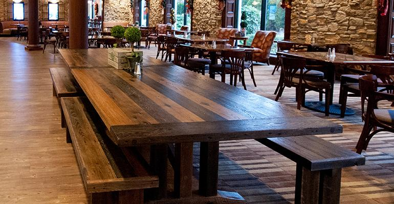 The remodeled Ciao Bella is reminiscent of a rustic Italian farm and features more woodwork with expansive columns and reclaimed barn wood for cabinetry