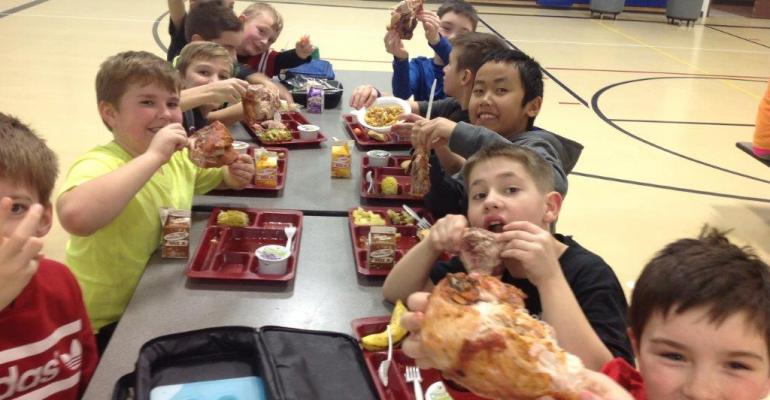Young Holmen Schools students enjoying a repeat of the Winner Winner Chicken Dinner event featuring chicken from birds raised by fellow district students