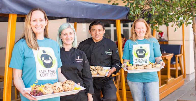 from left Marin Catholic teacher Mimi Murphy Epicurean Group CafeCatering Manager Nicole Price Epicurean Group Chef Manager Jose Rodriguez and Marin Catholic teacher Lynn Maloney with the Fair Trade chocolate muffin served at the school39s Fair Trade program launch event