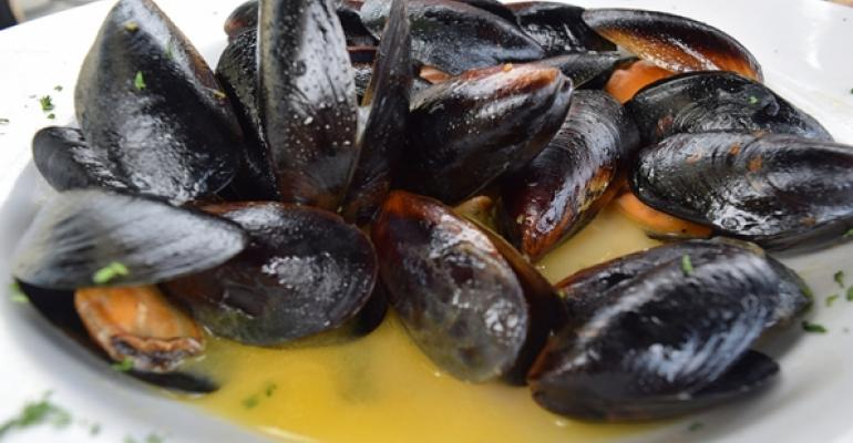 PUT SOME MUSSEL INTO IT When eating a mussel and broth dish like this one take your first mussel eat it and use the shell as tongs for the rest