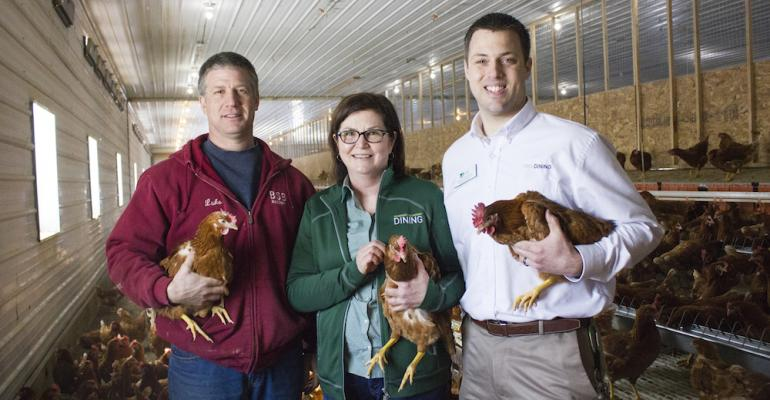 NMU Director of Dining Sharon Carey and Associate Director Paul Schoonveld right with Luke Bell of BSB Farms