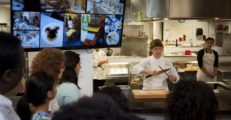 Chef Leah Sarris leads a knife skills instruction at an event at the Goldring Center hosted for licensee schools and organizations across the country
