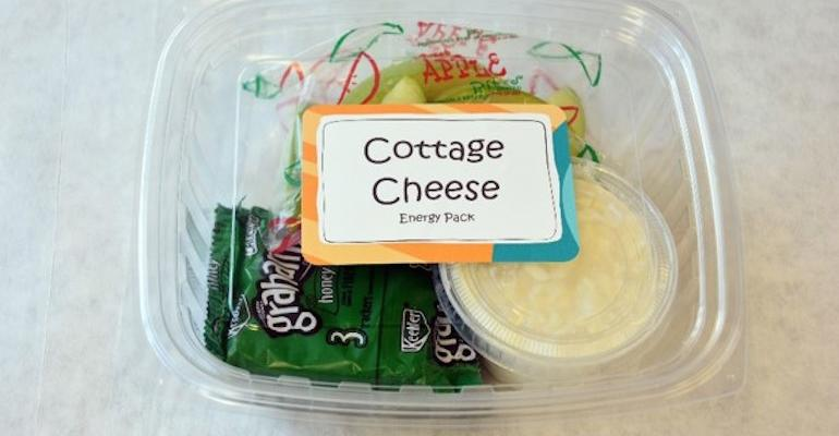 Cottage cheese with crackers and apple slices one of the Energy Pack combos available to Lakeside students