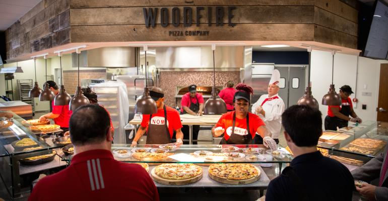 Woodfire is one of two pizza concepts that debuted at Liberty University It specializes in premium New York style pies by the slice while Hilltop Pizza offers whole pies for eatin takeout or delivery