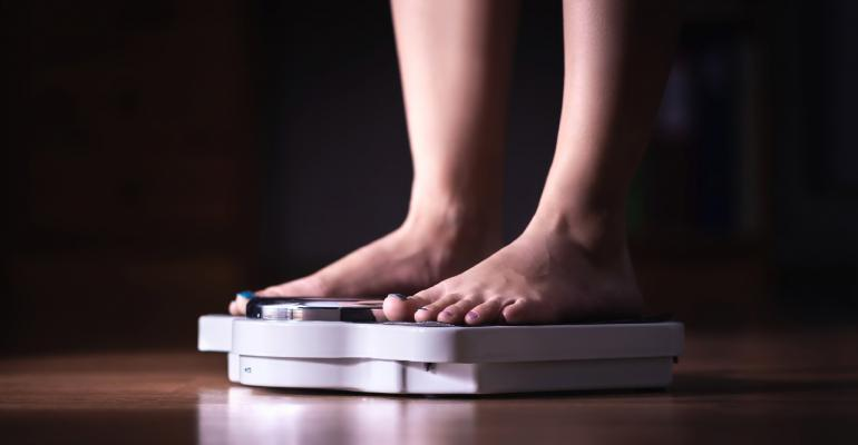 woman-feet standing-on-weigh-scales.jpg