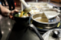ladeling_in_the_hot_soup_on_cold_preportioned_bowl_of_ingredients_Egan_HS.png