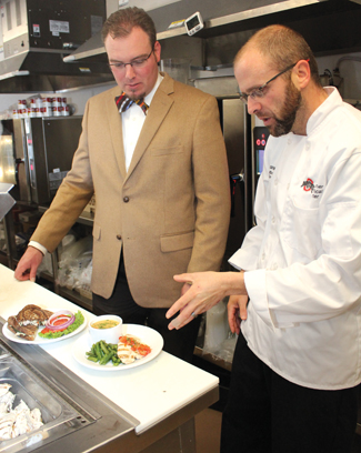 Mike Folino, RD, LD, assistant director of nutrition services and Chef Drew Patterson, culinary director at OSUMC, work together to create new menu items.
