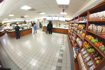Nutrition Services worked with hospital facilities staff to build custom wall-shelving for retail merchandising at the entrance to the main employee café.